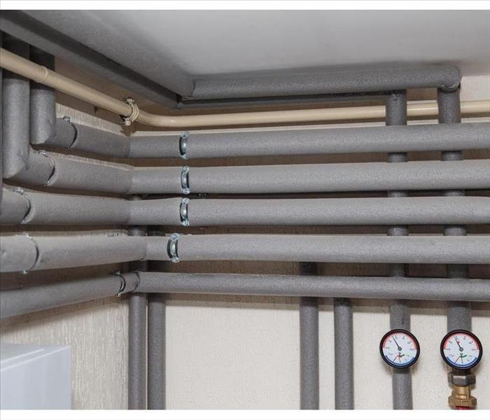 The pipelines in the insulation and pressure gauges flow and return pipes in the boiler room of a private house household