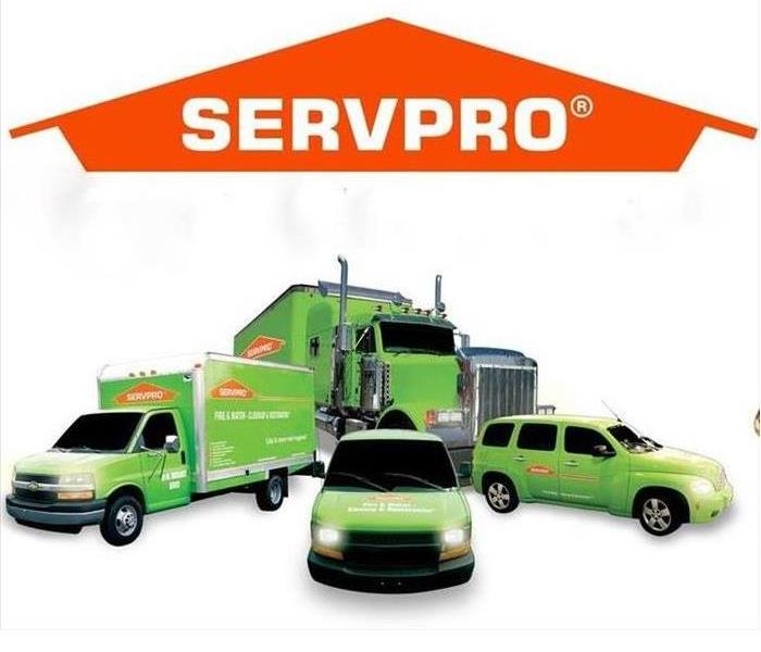 SERVPRO logo with 4 green vehicles